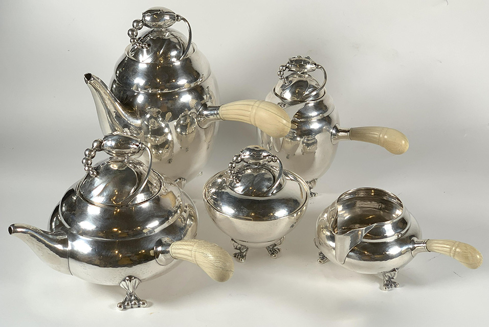 "Georg Jensen sterling silver 5-piece coffee service in the Blossom pattern, weighing 2,171 grams (or 69.79 oz. troy), all pieces stamped ""Georg Jensen Sterling Denmark"". Est. $4,000-$6,000."