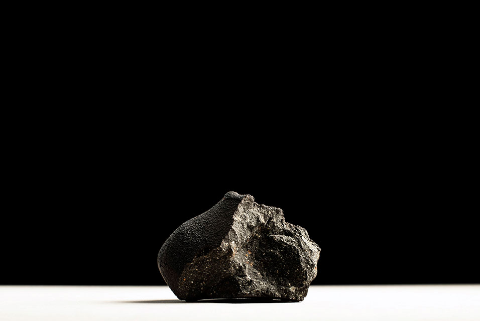 A piece of the Murchison meteorite that hit Australia in 1969 is displayed in New York on March 6, 2020. It is among space rocks to be included at an auction by Christie's. Karsten Moran/The New York Times.  by Kevin Coyne