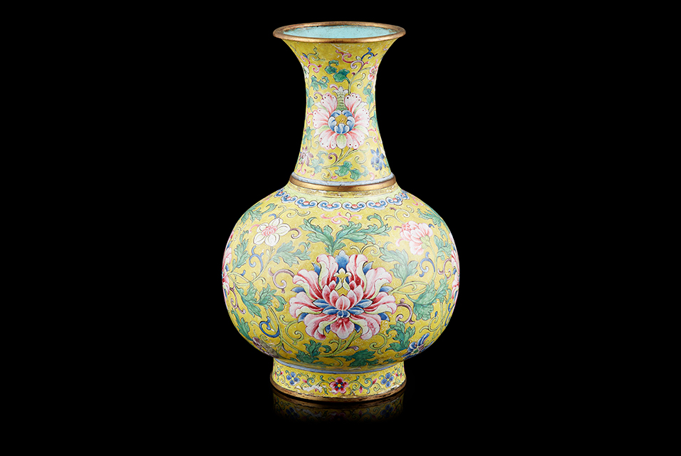 The Qianlong (1736-95) mark and period painted enamel lotus vase sold at £45,000.