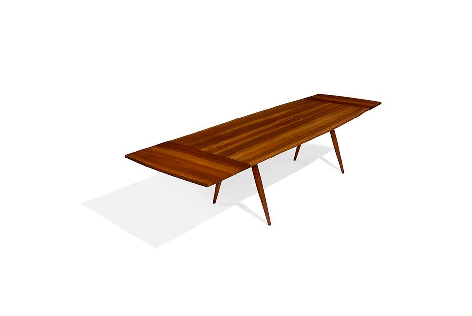 Lot 420: George Nakashima, splayed leg dining table. Estimate $8,000-12,000
