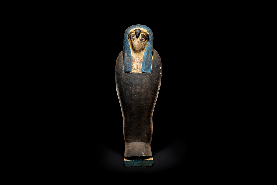 An Egyptian Wood Falcon Sarcophagus. Late Period, Dynasty 26-30, 664-343 B.C. Height 23 inches. Property from the Estate of Julia Reich, East Orange, New Jersey. Estimate: $5,000 - $7,000. Price Realized: $57,500.
