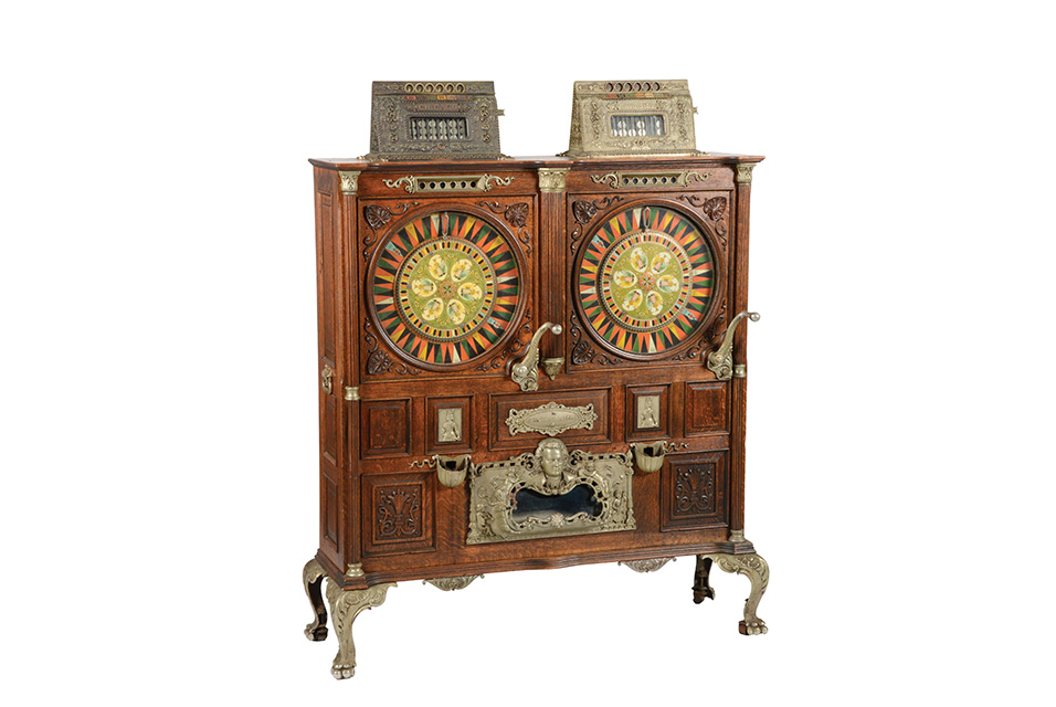Mills 'Twin Chicago' double upright slot machine that accepts both quarters ('Two Bits') and nickels, with musical attachment. All original from top to bottom and inside out. Sold within estimate for $79,950.
