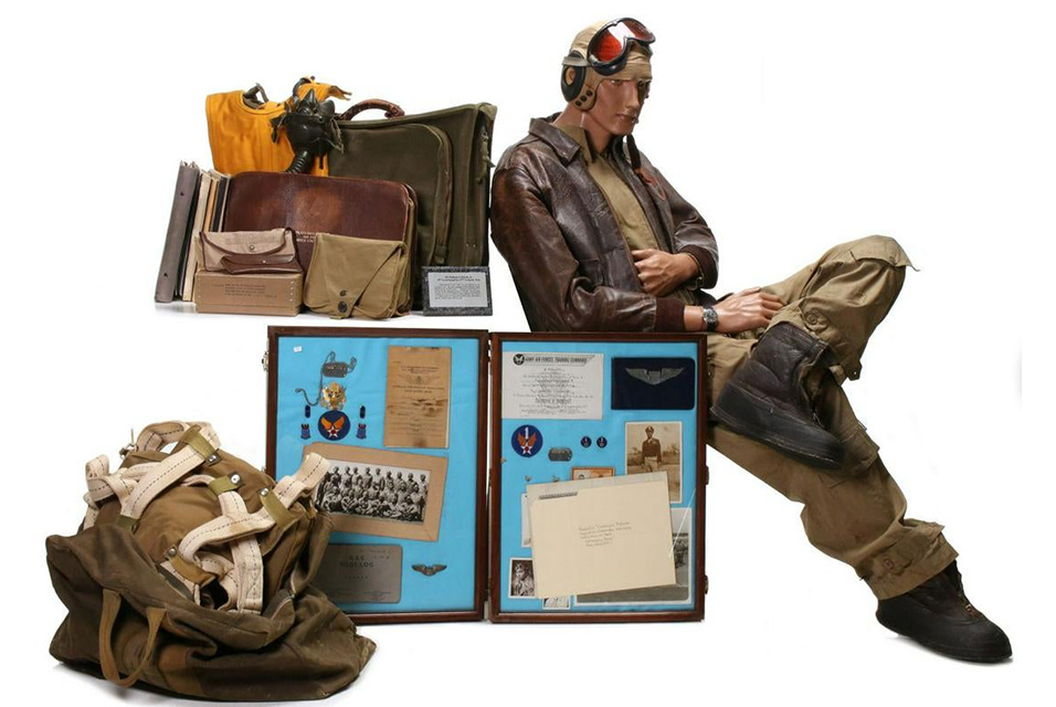 Important 75-piece archive of personal and service items belonging to Tuskegee Airman William S. Powell Jr. Uniform includes A-2 leather jacket with squadron patch and name, flight suit and other apparel with all insignia, parachute, kit bag, flight log, many documents including Tuskegee diploma with signatures of classmates and instructors. Estimate $40,000-$60,000.