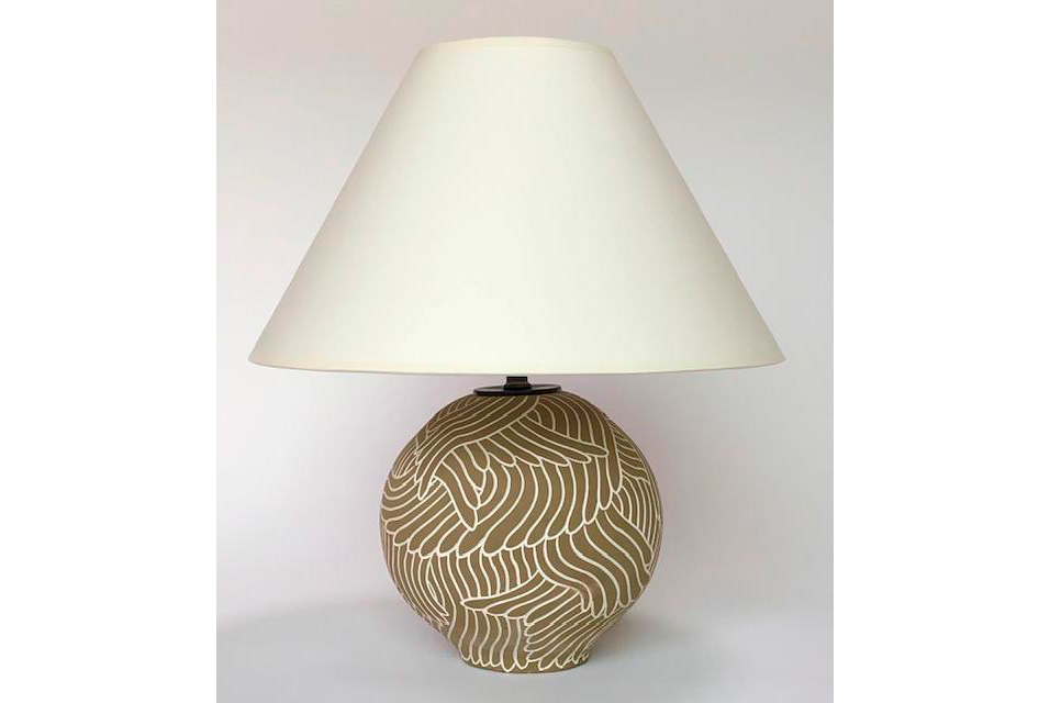 """Ceramic stoneware table lamp with spherical form on foot, white hand-carved feather drawing into a khaki background underglaze. Base measures 9"""" high x 8"""" wide. Shade measures 5.5' top x 8.5"""" slant x 15"""" bottom. Donated by David Netto."""