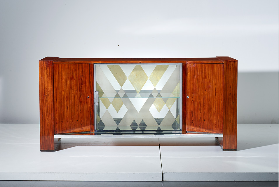 Charlotte Perriand, Unique sideboard, 1926. Brazilian rosewood, kingwood, ebonized wood, chromium-plated metal, glass, mirrored glass. 40 3/8 x 87 1/8 x 22 7/8 in. (102.6 x 221.3 x 58.1 cm). Estimate: $40,000 - 60,000. Image courtesy of Phillips.