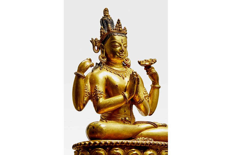 A Gilt Copper Alloy Figure of Shadakshari Lokeshvara. Khasa Malla, circa 1300-1350. Price realized: $956,075. Photo: Bonhams.