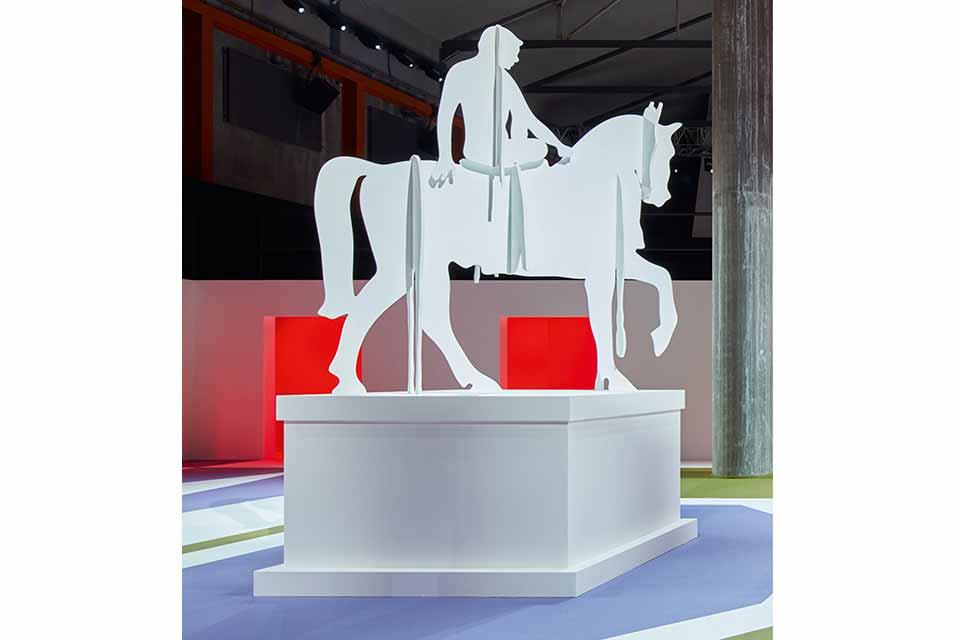 AMO - Rem Koolhaas, Anti-Hero Statue, Men's show centrepiece. Painted wood, height 370cm. Estimate €5,000-7,000. Courtesy Sotheby's.