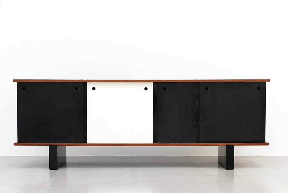 Galerie Patrick Seguin, Charlotte Perriand, Sideboard, 1958. Height 77cm Width 216cm Depth 46cm. Metal, mahogany, plastic drawers & doors. Image courtesy of Phillips.