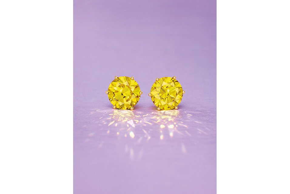 Lot 65: 3.03 and 3.01-Carat Natural Fancy Deep Yellow Diamond Earrings.