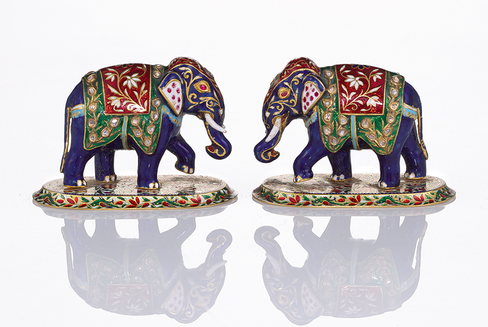 Anniversary Gifts: A pair of jewelled gold and enamel elephants, Jaipur, 1946 (est. £2,000-3,000), and a Fabergé silver-gilt inkwell, probably workmaster Julius Rappoport, St Petersburg, circa 1900 (est. £4,000-6,000). Courtesy Sotheby's.