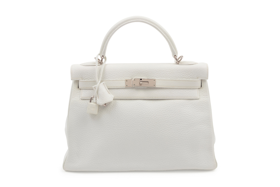 Hermès White Leather 32cm Kelly Bag, 2004. White leather Kelly bag with top handle, detachable shoulder strap, and front twist lock closure. Presale Estimate: $4,000 - $6,000. Price Realized: $11,250.